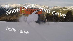 joel bardoux, nomad snowboard en elbow carve, euro carve, body carve dessous une banderole ralentir